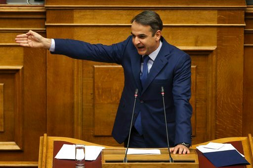 (AP Photo/Petros Giannakouris). New Democracy party leader Kyriakos Mitsotakis addresses lawmakers during a parliamentary session where he submitted a motion of no confidence against Prime Minister Alexis Tsipras, in Athens, on Thursday, June 14, 2018....
