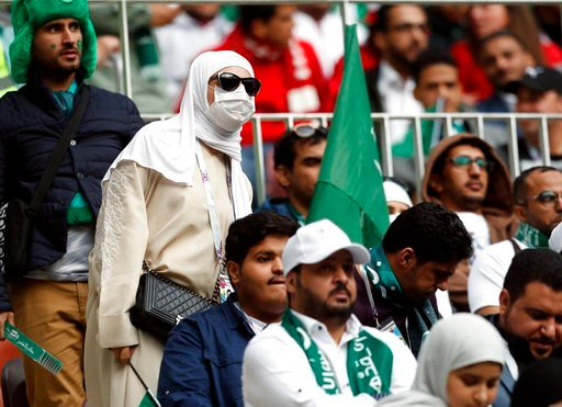 (AP Photo/Pavel Golovkin). Saudi Arabia fans wait for the start of the group A match between Russia and Saudi Arabia which opens the 2018 soccer World Cup at the Luzhniki stadium in Moscow, Russia, Thursday, June 14, 2018.
