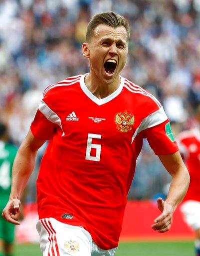 (AP Photo/Matthias Schrader). Russia's Denis Cheryshev celebrates after scoring his side's second goal during the group A match between Russia and Saudi Arabia which opens the 2018 soccer World Cup at the Luzhniki stadium in Moscow, Russia, Thursday, J...