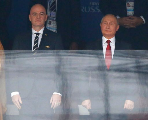 (AP Photo/Hassan Ammar). FIFA President Gianni Infantino, left, and Russian President Vladimir Putin stand for the athem prior to the match between Russia and Saudi Arabia which opens the 2018 soccer World Cup at the Luzhniki stadium in Moscow, Russia,...