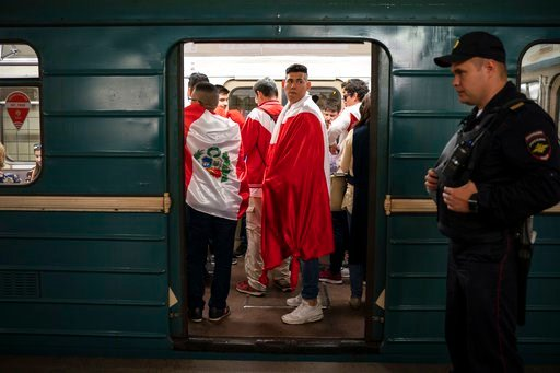 (AP Photo/Felipe Dana). Soccer fans ride in the metro near the Luzhniki stadium before the group A match between Russia and Saudi Arabia which opens the 2018 soccer World Cup in Moscow, Russia, Thursday, June 14, 2018.
