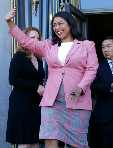 (AP Photo/Jeff Chiu). London Breed waves before speak to reporters outside of City Hall in San Francisco, Wednesday, June 13, 2018. Breed was poised to become the first African-American woman to lead San Francisco following a hard-fought campaign when ...