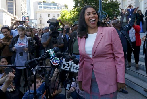 (AP Photo/Jeff Chiu). London Breed smiles toward supporters before speaking to reporters outside of City Hall in San Francisco, Wednesday, June 13, 2018. Breed was poised to become the first African-American woman to lead San Francisco following a hard...