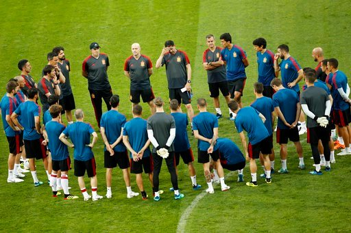 (AP Photo/Francisco Seco). Spain head coach Fernando Hierro, top centre, touches his forehead as gives instructions to his players during Spain's official training on the eve of the group B match between Portugal and Spain at the 2018 soccer World Cup ...