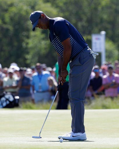 (AP Photo/Julio Cortez). Tiger Woods misses a putt on the seventh hole during the first round of the U.S. Open Golf Championship, Thursday, June 14, 2018, in Southampton, N.Y.