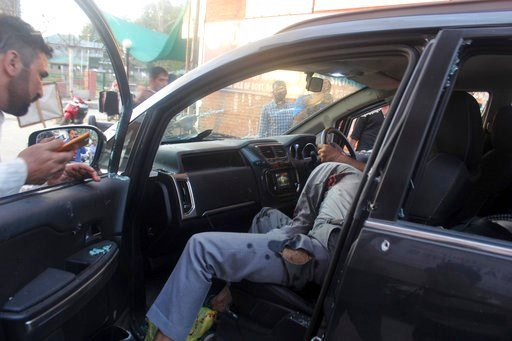 (AP Photo). The body of senior journalist Shujaat Bukhari lies lifeless inside a car after an attack in Srinagar, in Indian-controlled Kashmir, Thursday, June 14, 2018. Bukhari and his bodyguard were fatally shot as he left his office. Police said the ...