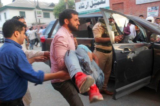 (AP Photo). The police bodyguard of senior journalist Shujaat Bukhari is carried away after an attack in Srinagar, in Indian-controlled Kashmir, Thursday, June 14, 2018. Bukhari and his bodyguard were fatally shot as he left his office. Police said the...