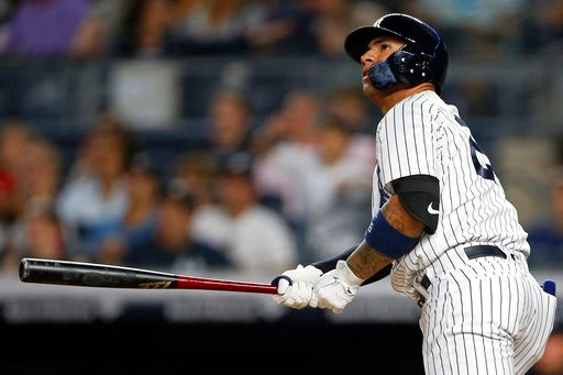 (AP Photo/Adam Hunger). New York Yankees' Gleyber Torres watches his three-run home run against the Tampa Bay Rays during the fifth inning of a baseball game Thursday, June 14, 2018, in New York.
