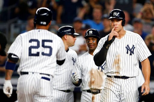 (AP Photo/Adam Hunger). New York Yankees' Gleyber Torres (25) is welcomed by teammates, including Aaaron Judge, right, after hitting a three-run home run during the fifth inning of the team's baseball game against the Tampa Bay Rays on Thursday, June 1...