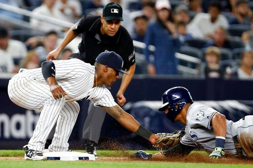 (AP Photo/Adam Hunger). New York Yankees third baseman Miguel Andujar tags out Tampa Bay Rays' Carlos Gomez on an attempted steal of third base during the seventh inning of a baseball game Thursday, June 14, 2018, in New York. Third base umpire Gabe Mo...