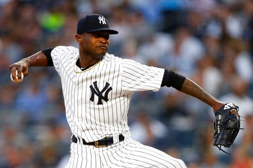 (AP Photo/Adam Hunger). New York Yankees' Domingo German winds up during the fourth inning of the team's baseball game against the Tampa Bay Rays on Thursday, June 14, 2018, in New York.
