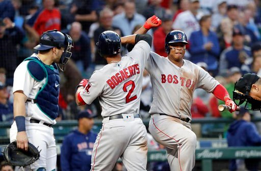 (AP Photo/Elaine Thompson). Boston Red Sox's Xander Bogaerts (2) is congratulated on his solo home run by Rafael Devers as Seattle Mariners catcher Mike Zunino stands nearby during the sixth inning of a baseball game Thursday, June 14, 2018, in Seattle.