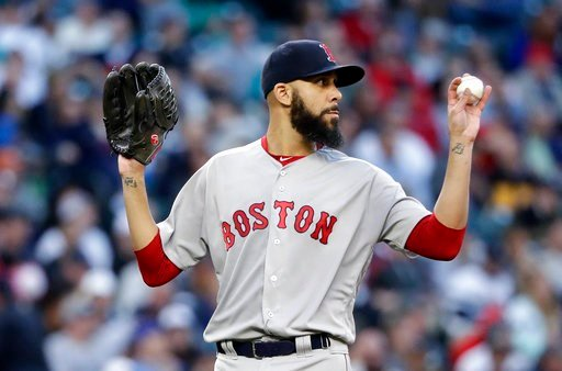 (AP Photo/Elaine Thompson). Boston Red Sox starting pitcher David Price calls for a new ball after giving up two hits to the Seattle Mariners during the fifth inning of a baseball game Thursday, June 14, 2018, in Seattle.