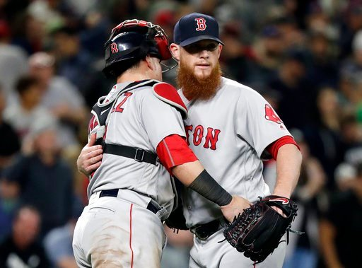 (AP Photo/Elaine Thompson). Boston Red Sox closing pitcher Craig Kimbrel, right, embraces catcher Christian Vazquez after the Red Sox defeated the Seattle Mariners 2-1 in a baseball game Thursday, June 14, 2018, in Seattle.