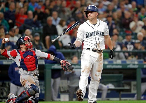 (AP Photo/Elaine Thompson). Seattle Mariners' Kyle Seager flips his bat after striking out swinging as Boston Red Sox catcher Christian Vazquez returns the ball to the pitcher during the seventh inning of a baseball game Thursday, June 14, 2018, in Sea...