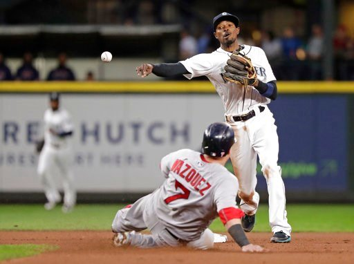 (AP Photo/Elaine Thompson). Seattle Mariners second baseman Dee Gordon, right, throws to first after forcing out Boston Red Sox's Christian Vazquez at second base in the seventh inning of a baseball game Thursday, June 14, 2018, in Seattle. Mookie Bett...