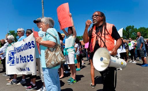 (Christopher Millette/Erie Times-News via AP). Gary Horton, at right, president of the Erie chapter of the NAACP, organized about 160 people as they prepared to march from the Martin Luther King Center, 312 Chestnut St., to Perry Square in Erie on Thur...