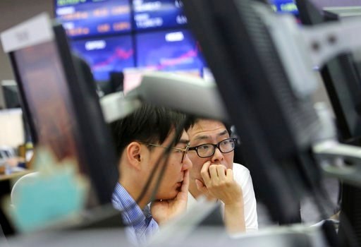 (AP Photo/Ahn Young-joon). Currency traders watch monitors at the foreign exchange dealing room of the KEB Hana Bank headquarters in Seoul, South Korea, Friday, June 15, 2018. Asian stock markets were mixed Friday after Wall Street largely finished wit...
