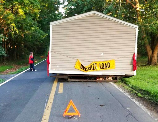 (Dover Delaware Police Department via AP). This June 26, 2018 photo provided by the Dover Delaware Police Department shows a prefabricated home that was abandoned on a roadway in Dover, Del. Dover Police Department said someone left the home on a two-l...
