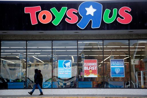 (AP Photo/Julio Cortez, File). This Jan. 24, 2018, file photo shows a person walking near the entrance to a Toys R Us store, in Wayne, N.J. Toys R Us is closing its last U.S. stores by Friday, June 29, the end of a memorable chain.
