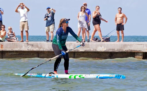 (Carol Tedesco/Florida Keys News Bureau via AP). In this photo provided by the Florida Keys News Bureau, Victoria Burgess, 34, paddles the last few hundred feet to Key West, Fla., from Cuba Wednesday, June 27, 2018. It took Burgess nearly 28 hours to m...