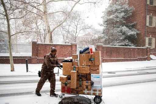 (AP Photo/Matt Rourke, File). FILE- In this Dec. 15, 2017, file photo, a United Parcel Service worker makes his deliveries during a snowstorm in Philadelphia. Amazon's Prime shipping program set the pace for shoppers' expectations, and the nation's lar...