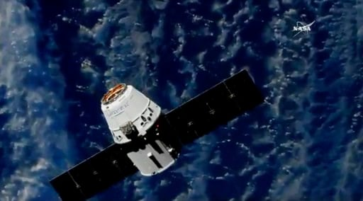 (NASA TV via AP). In this frame from NASA TV, a SpaceX cargo capsule approaches the International Space Station on Monday, July 2, 2018, to deliver the first robot with artificial intelligence in orbit.
