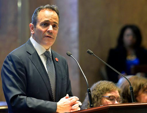 (AP Photo/Timothy D. Easley, File). FILE - In this Tuesday, Jan. 16, 2018 file photo, Kentucky Gov. Matt Bevin speaks to a joint session of the General Assembly at the Capitol in Frankfort, Ky. A federal judge says Kentucky can't require poor people to...