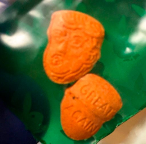 """(Indiana State Police Peru Post via AP). This undated image provided by the Indiana State Police Peru Post shows what police describe as """"Trump-shaped ecstasy pills."""" They are orange and stamped with a face. On the back are the words """"great again,"""" an ..."""