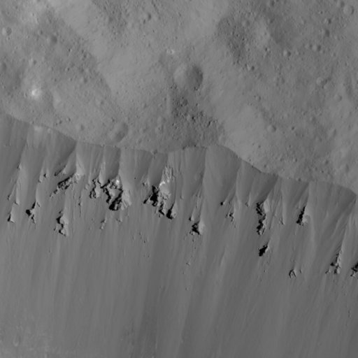 (NASA via AP). This image showing landslides along Occator Crater's rim was obtained by NASA's Dawn spacecraft on June 9, 2018 from an altitude of about 27 miles. Dawn has been orbiting Ceres since 2015, after first exploring the asteroid Vesta. They'r...