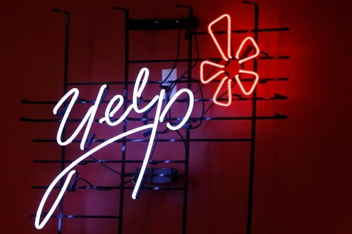 (AP Photo/Kathy Willens, File). FILE - This Oct. 26, 2011, file photo shows the logo of the online reviews website Yelp in neon on a wall at the company's Manhattan offices in New York. A divided California Supreme Court has ruled that online review si...