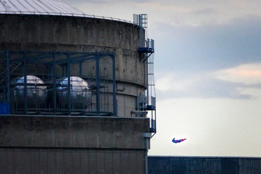 (Nicolas Chauveau/Greenpeace via AP). In this photo released by Greenpeace, a drone resembling the character of Superman flies over the nuclear power plant of Le Bugey, central, France, Tuesday, July 3, 2018. The environmental activist group says the d...