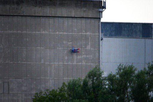 (Nicolas Chauveau/Greenpeace via AP). In this photo released by Greenpeace, a drone resembling the character Superman crashes into a wall of the nuclear power plant of Le Bugey, central, France, Tuesday, July 3, 2018. The environmental activist group s...