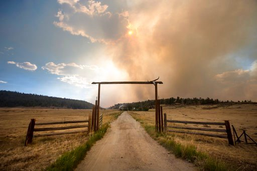 (Hugh Carey/Summit Daily News via AP). The Weston Pass Fire threatens homes along Highway 285, Monday, July 2, 2018, near Fairplay, Colo. In Colorado, more than 2,500 homes were under evacuation orders as firefighters battled more than a half-dozen wil...