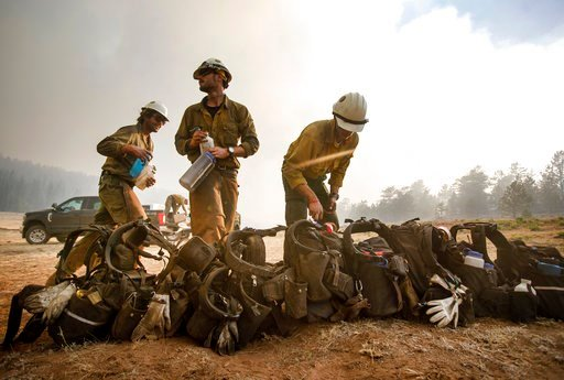 (Hugh Carey/Summit Daily News via AP). Craig Hotshots firefighters take a break from battling the Weston Pass Fire, Monday, July 2, 2018, near Fairplay, Colo. In Colorado, more than 2,500 homes were under evacuation orders as firefighters battled more ...