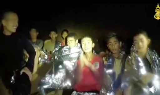 (Thai Navy Seal via AP). In this July 3, 2018, image taken from video provided by the Thai Navy Seal, Thai boys are with Navy SEALs inside the cave, Mae Sai, northern Thailand. With heavy rains forecast to worsen flooding in a cave in northern Thailand...
