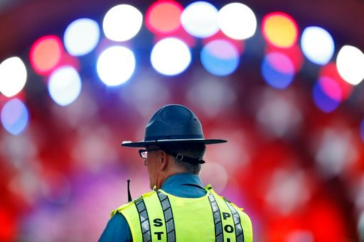 (AP Photo/Michael Dwyer). A Massachusetts State Police officer stands watch during rehearsal for the Boston Pops Fireworks Spectacular in Boston, Tuesday, July 3, 2018.