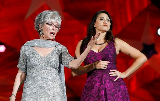 (AP Photo/Michael Dwyer). Rita Moreno and Natalie Cortez perform during rehearsal for the Boston Pops Fireworks Spectacular in Boston, Tuesday, July 3, 2018.