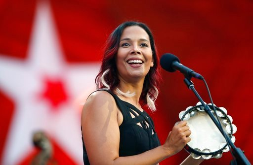 (AP Photo/Michael Dwyer). Rhiannon Giddens performs during rehearsal for the Boston Pops Fireworks Spectacular in Boston, Tuesday, July 3, 2018.