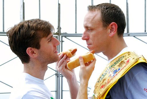 (Photo by Evan Agostini/Invision/AP). Carmen Cincotti, left, poses in a stare-down with defending champion Joey Chestnut during Nathan's Famous International Fourth of July Hot Dog Eating Contest weigh-in at the Empire State Building on Tuesday.