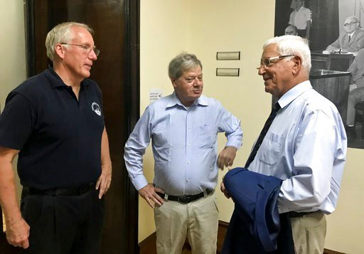 (AP Photo/ Lazar Semini). James Goold, center, chairman of the RPM Nautical Foundation, talks with David Ruff, left, of the not-for-profit US Institute of Nautical Archaeology research organization, and Neritan Ceka, Albanian archaeologist, before the ...