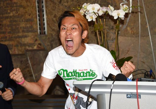 (Photo by Evan Agostini/Invision/AP). Max Suzuki participates in Nathan's Famous International Fourth of July Hot Dog Eating Contest weigh-in at the Empire State Building on Tuesday, July 3, 2018, in New York.