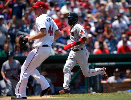(AP Photo/Nick Wass). Boston Red Sox' Eduardo Nunez, right, runs towards home to score on a wild pitch by Washington Nationals relief pitcher Ryan Madson (44) during the seventh inning of a baseball game, Wednesday, July 4, 2018, in Washington.