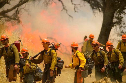 (Randall Benton/The Sacramento Bee via AP). Hot Shot crews from Mendocino use backfires to help contain the County Fire along Highway 129 near Lake Berryessa in Yolo County, California, on Tuesday, July 3, 2018.