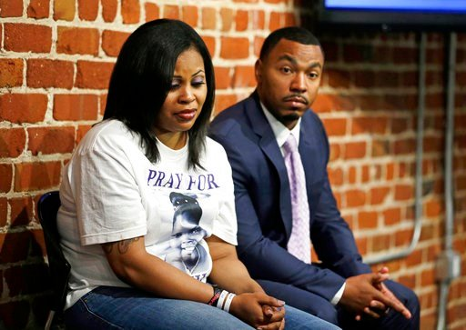 (AP Photo/Eric Risberg, File). FILE - In this Oct. 3, 2014, file photo, Nailah Winkfield, left, and Omari Sealey, right, the mother and uncle of Jahi McMath, listen to doctors speak during a news conference in San Francisco. The mother of a girl at the...