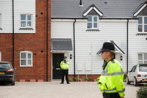 (AP Photo/Matt Dunham). British police officers stand outside a residential property in Amesbury, England, Wednesday, July 4, 2018.