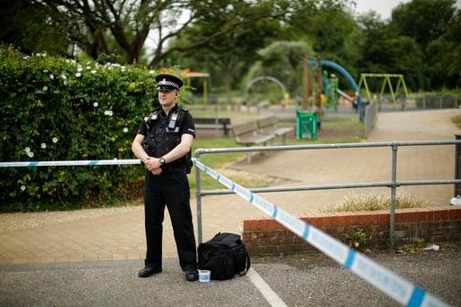 (AP Photo/Matt Dunham). A British police officer guards a cordon outside the Queen Elizabeth Gardens park in Salisbury, England, Wednesday, July 4, 2018.