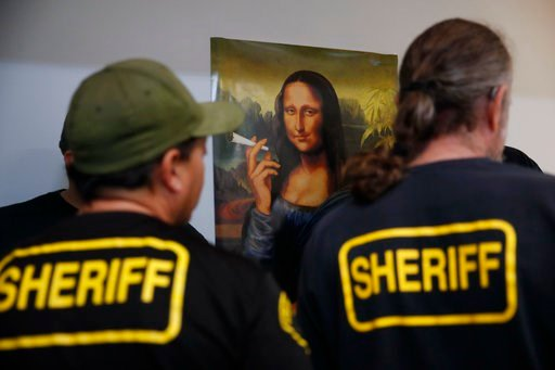 (AP Photo/Jae C. Hong). In this March 15, 2018 photo, a group of undercover Los Angeles County sheriff's deputies gather inside an illegal marijuana dispensary during a raid in Compton, Calif. California ushered in broad marijuana legalization nearly s...