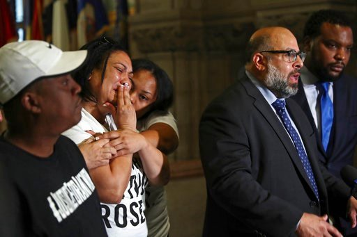 (Harrison Jones/Pittsburgh Tribune-Review via AP, File). FILE – In this June 27, 2018, file photo, Michelle Kenney, second from left, the mother of Antwon Rose Jr., reacts and Antwon Rose, left, the boy's father, listens as attorney Fred Rabner, second...