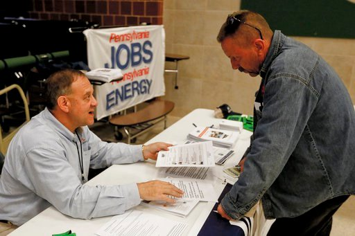 (AP Photo/Keith Srakocic, File). FILE - In this Thursday, Nov. 2, 2017, photo, a recruiter in the shale gas industry, left, speaks with an attendee of a job fair in Cheswick, Pa.  Employers in the United States are thought to have kept up their brisk p...